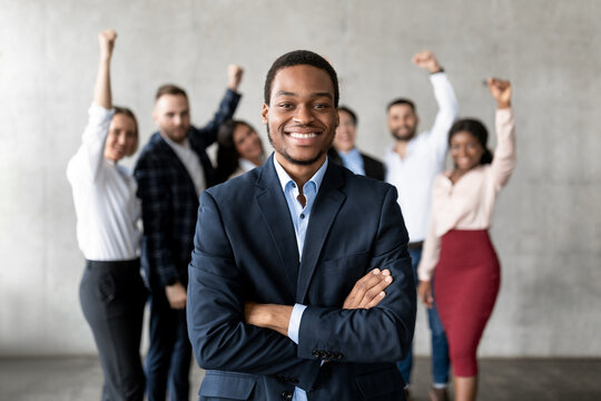 Successful Black Businessman Standing In Front Of Business Team Indoor