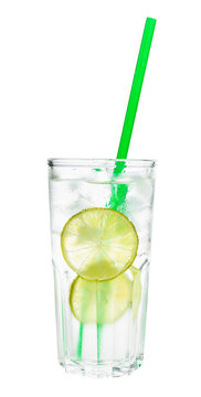 side view of gin and tonic cocktail in highball glass with two slices of lime, ice and green plastic straw isolated on white background