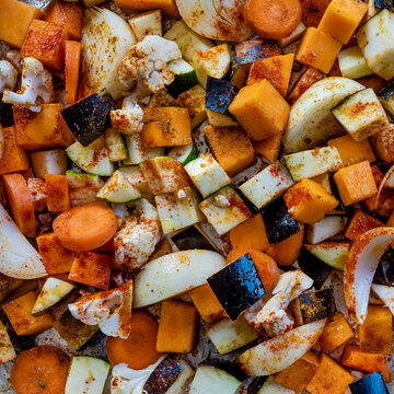 Close up of chopped  vegetables ready to be cooked in an oven.