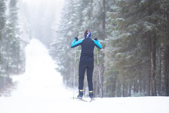 Cross country Skilling. A skier goes skiing on the ski track.