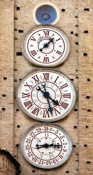 Italy, Tolentino central square of the city, Clock Tower, watch dials mark the phases of the moon, the Italian clock and astronomical clock