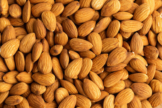 Close-up of almond pile ,Top view background