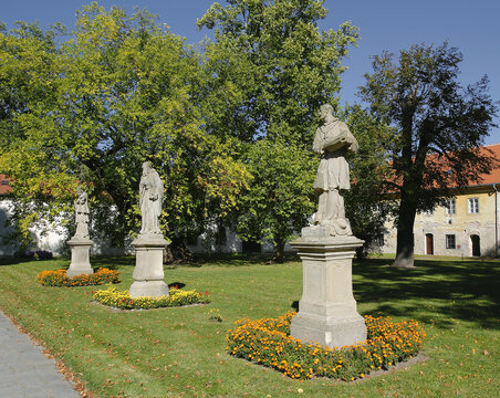 Rajhrad - Statues in the baroque monastery garden. Benedictine monastery and abbey of Rajhrad is the oldest monastery in Moravia, Czech Republic