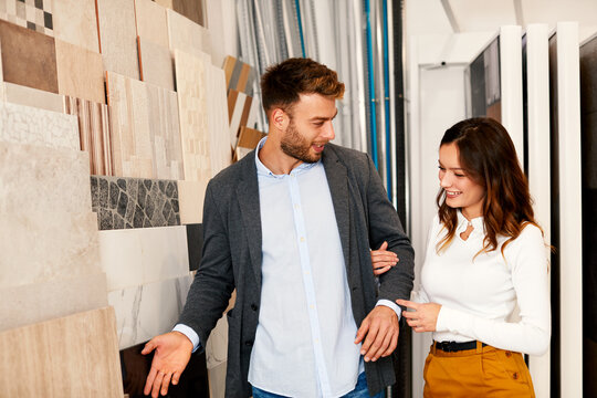 Young couple buys wall tiles for a new home