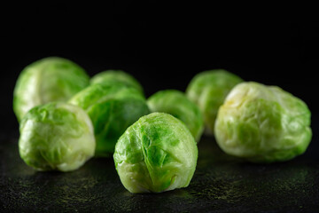 Fresh brussels sprouts on dark slate