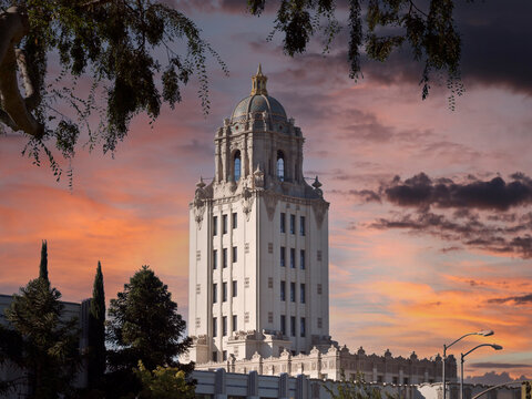 Beverly Hills City Hall building with sunset sky.