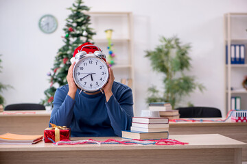 Young male student preparing for exams during new year celebrati