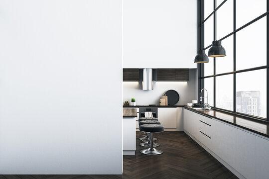 Modern kitchen studio interor with blank wall.