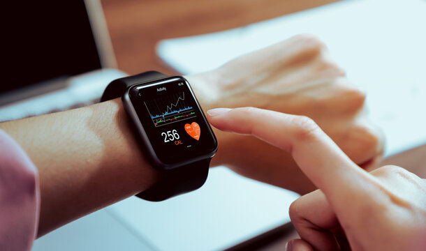 Close up of hand touching smartwatch with health app on the screen, gadget for fitness active lifestyle.