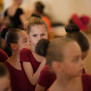 afraid little caucasian girls in scene suit backstage during show rehearsal in russian ballet dance school