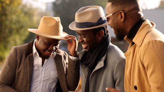 African friends talks in a city street