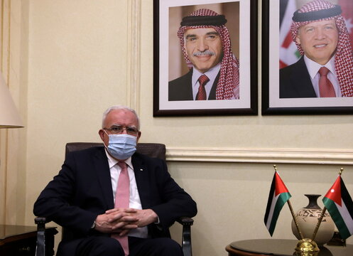 Palestinian Foreign Minister al-Maliki sits during his meeting with Jordanian counterpart in Amman