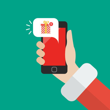 Santa Claus holding smartphone with gift box notification