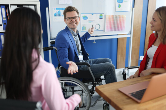 Businessman in wheelchair holds business conference in office. Small and medium business development concept