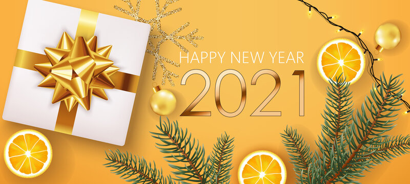 New year composition of golden numbers with white gift box, pine twigs, slices of lemon, christmas balls, festive lights and silver snowflake in background. Realistic 3D mockup product placement