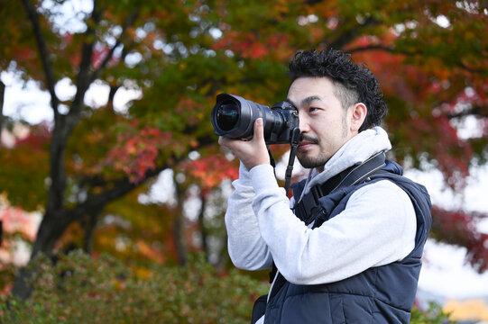 日本人のカメラマンコピースペース付き