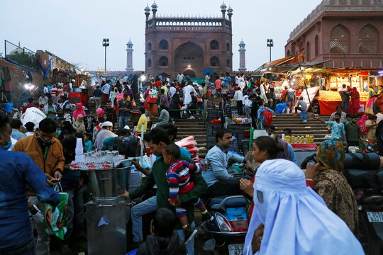People shop at a market in front of the Jama Masjid (Grand Mosque) in the old quarters of Delhi