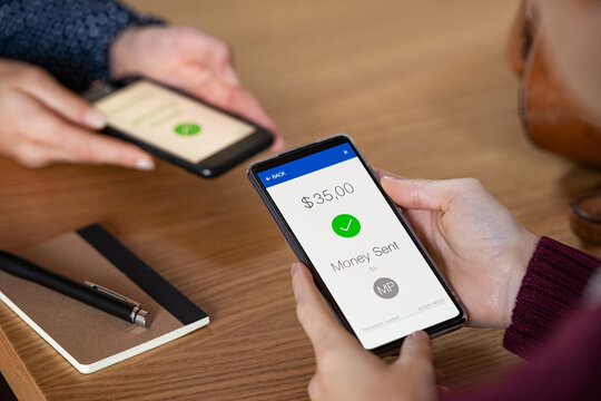 Woman sending money with phone