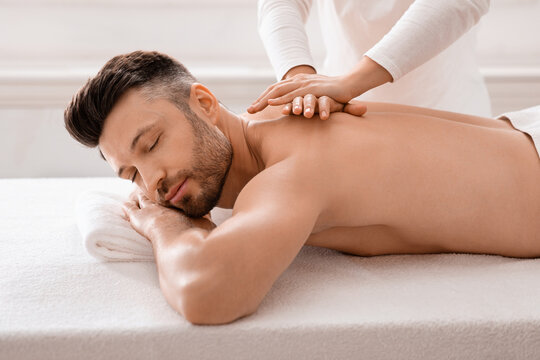 Relaxed man having manual therapy session at spa