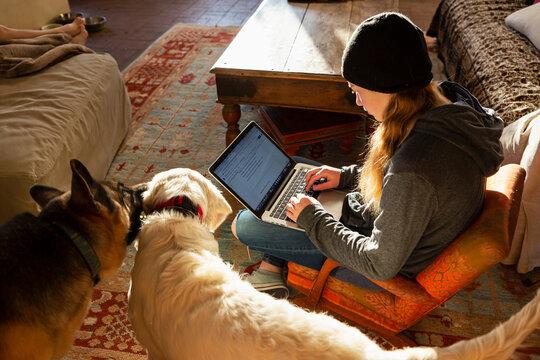 teenage girl using her laptop early morning