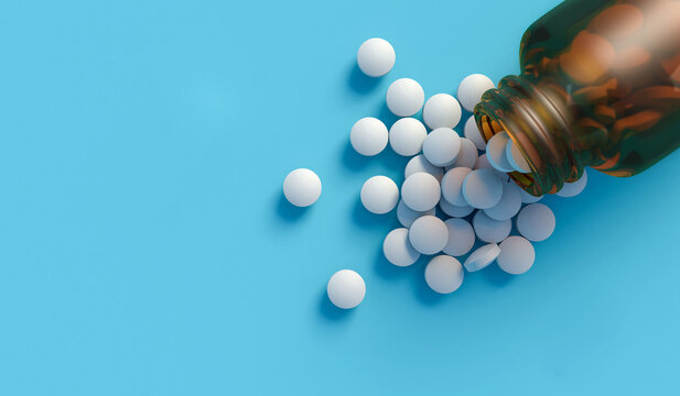 White tablets spilling out of a glass bottle isolated on blue backdrop with space for text. 3d illustration top down view.