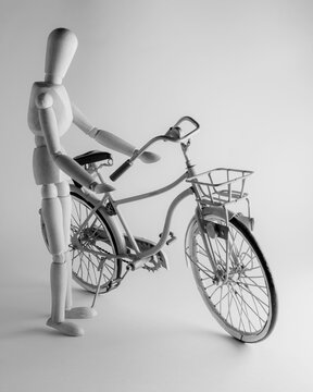 still life with wooden mannequin and metal bike model