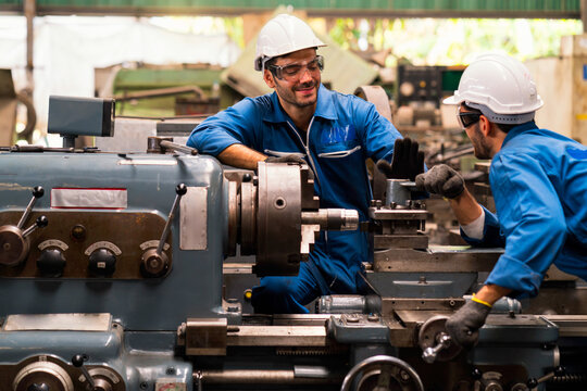 Engineers and skilled technicians are maintaining machinery. Engineers are working and repairing machines in industrial.