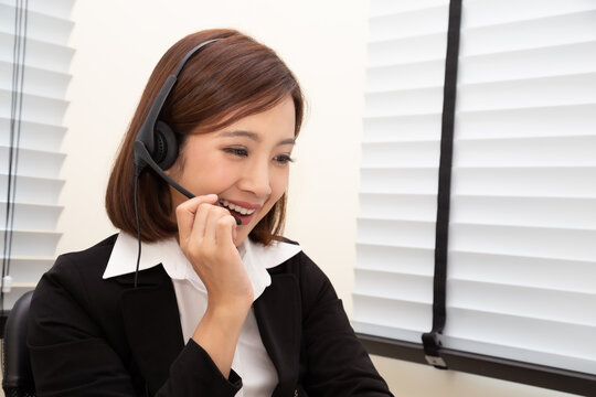 Asian woman call center with headphone, Telemarketing sales or Customer service operators in headsets concept