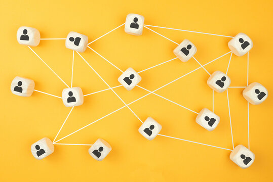 connections between people, social network concept with wooden blocks on colored background