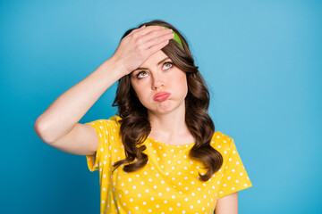 Frustrated tired girl touch forehead with hand look copyspace sigh wear yellow green clothes...