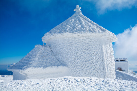 amazing winter landscape with hoar frost on building