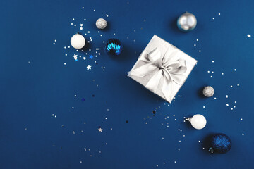Blue Christmas background of gift box and decorations. The concept of the winter holidays. Flat...