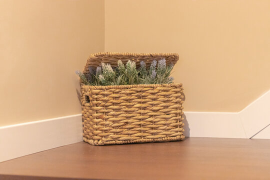 detail of skein basket intertwined with lavender flowers inside