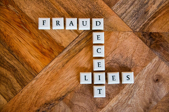 Letter blocks spelling out the words fraud deceit and lies