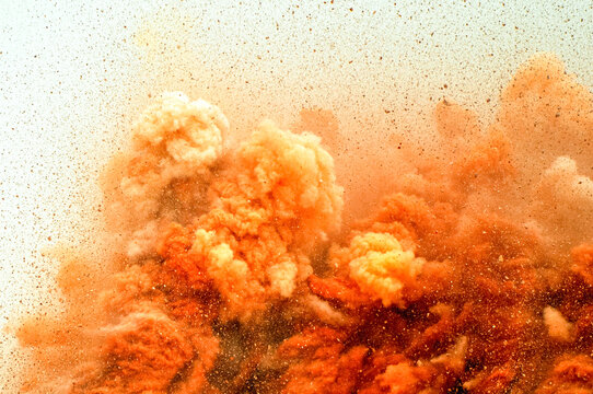 Flying rock particles and dust storm after detonator blast in the desert
