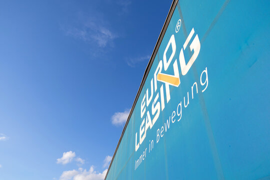 CUXHAVEN, GERMANY - OCTOBER 26, 2020: Euroleasing logo at curtain side semitrailer against blue sky.