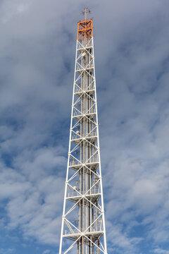 radio mast against cloudy sky