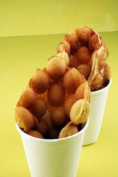 Hong Kong style egg waffle on table. bubble waffle on street food festival