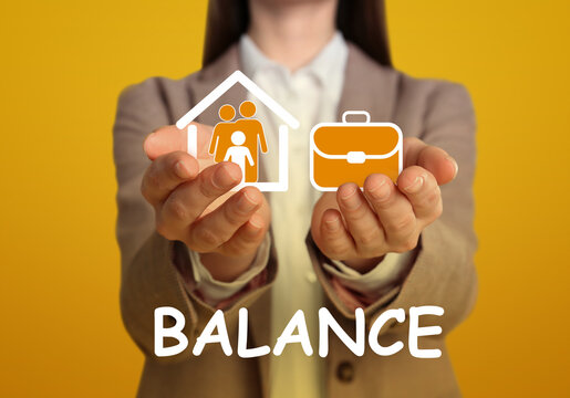 Woman holding virtual icons against yellow background, closeup. Concept of balance between life and work