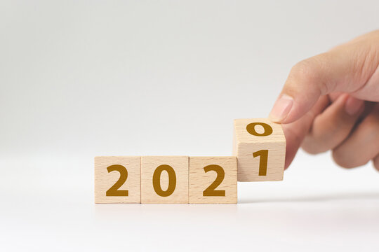 New year 2020 change to 2021 concept. Hand flip over wood cube block