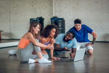 Group of dancers watching a dancing video in the class