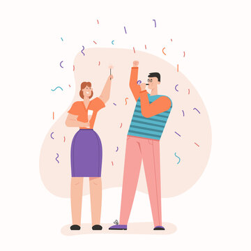 Man and woman celebrating at party with confetti