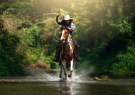 Western cowboy riding in the water