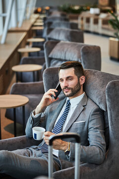 Satisfied business executive having a phone talk