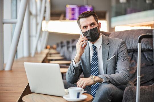 Entrepreneur listening to his phone conversation partner