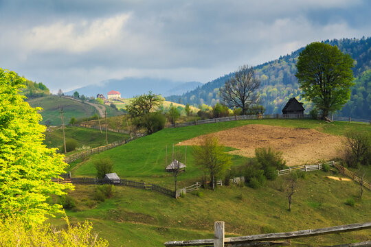 Spring morning rural landscape with cute farm outside the fence in the Mizhhiria, Carpathian mountains.