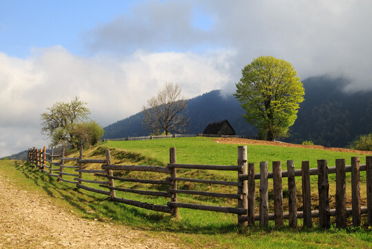 Spring morning landscape with the picturesque little farm in the Carpathian Mountains, Mizhhiria
