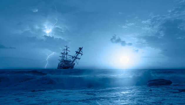 Silhouette of sailing old ship in a stormy sea,  amazing lightning in the background