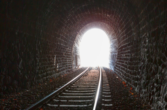 At the end of the railway tunnel with light