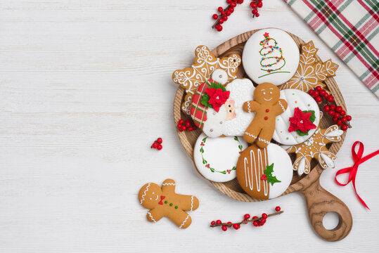 Christmas homemade gingerbread cookies on wooden plate with copy space